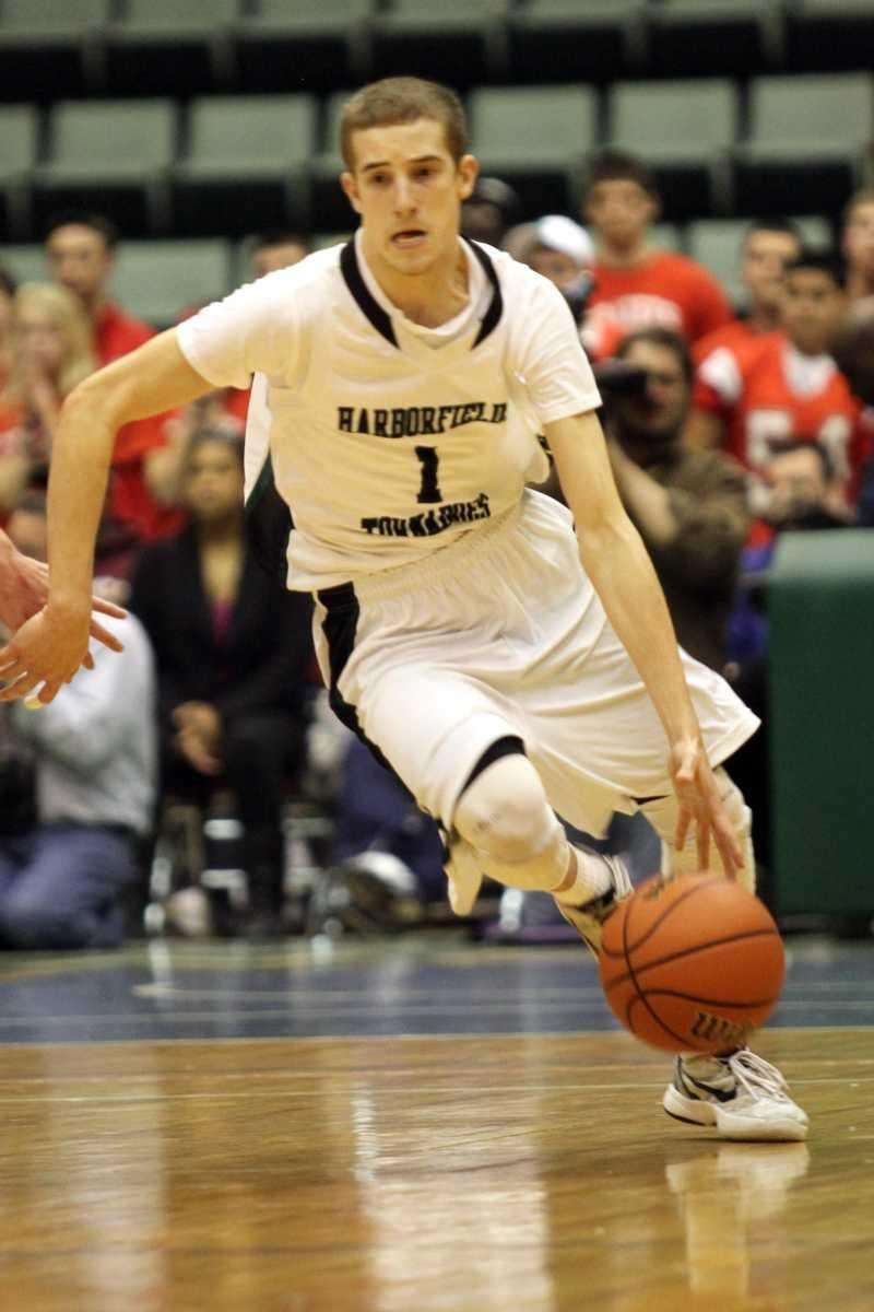 Harborfields' Lucas Woodhouse drives up court during their
