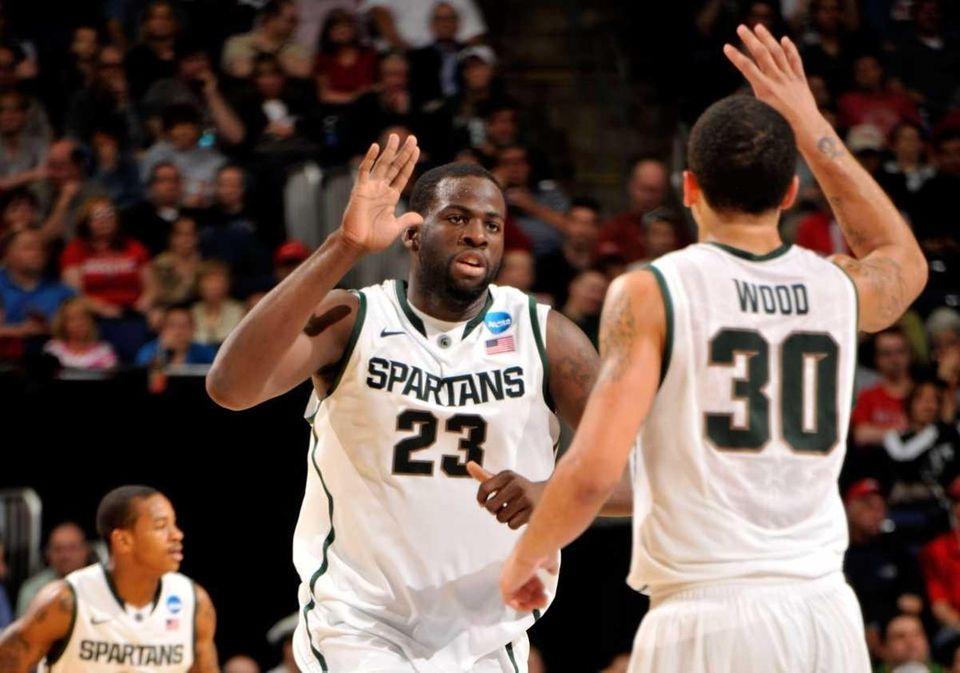 Draymond Green #23 and Brandon Wood #30 of
