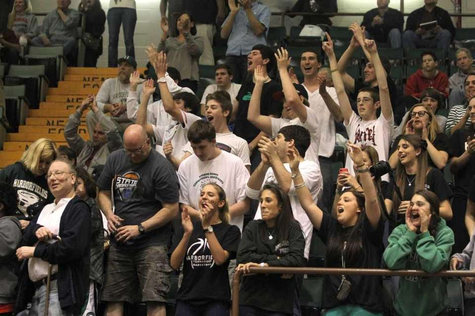 Harborfields fans celebrate after their win over Tappan