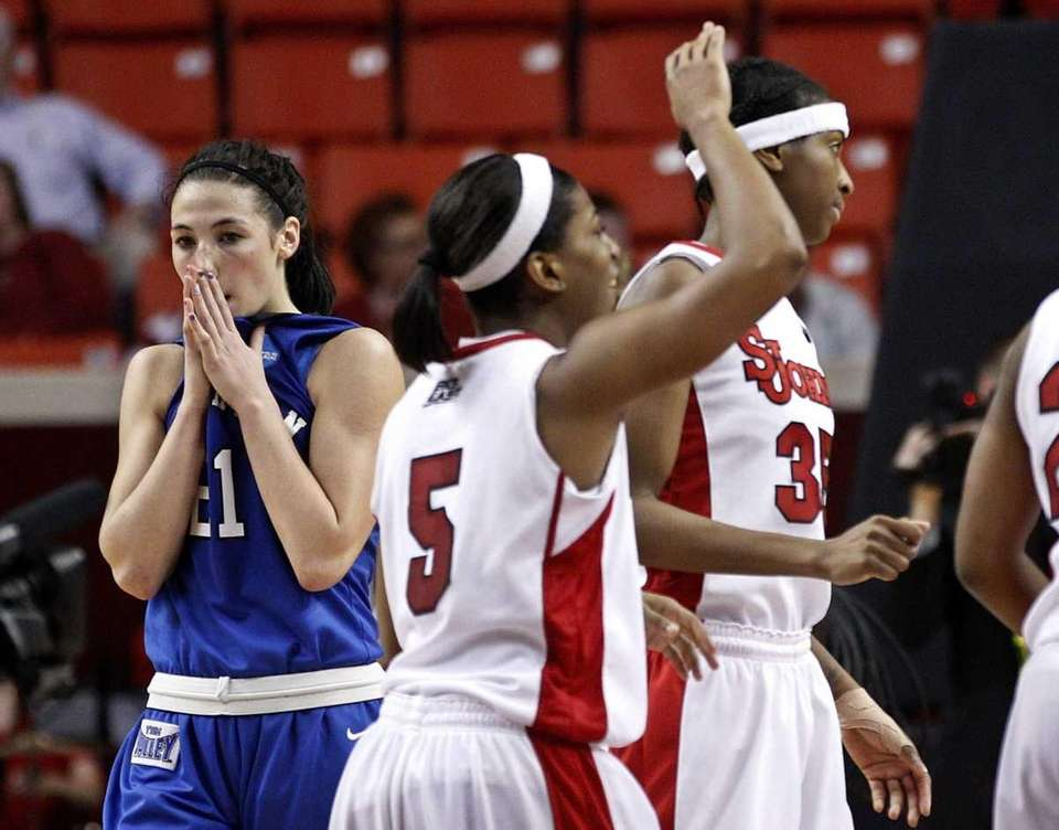 Creighton guard Carli Tritz, left, walks off the