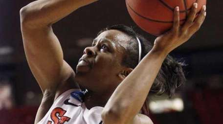 St. John's guard Eugeneia McPherson (22) shoots in