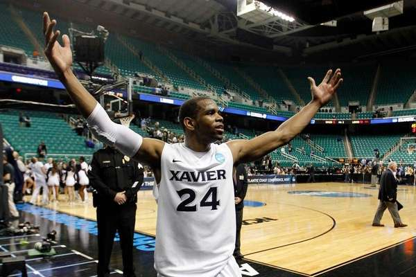 Tu Holloway of the Xavier Musketeers celebrate the