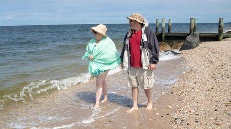 Elizabeth and Fred Rosenberg, of Aquebogue, walk along