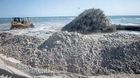 The Trailing Suction Hopper Dredger vessel blows sand