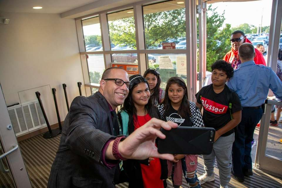 Roger Bloom assistant Superintendent, takes a selfie with