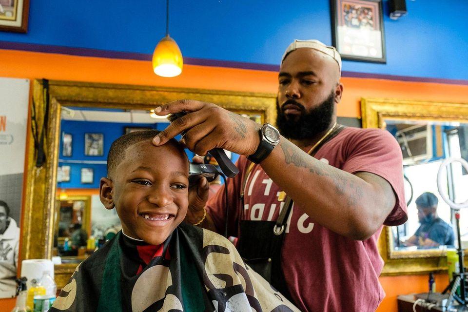 Jalani Fenner 6 of Roosevelt gets a haircut