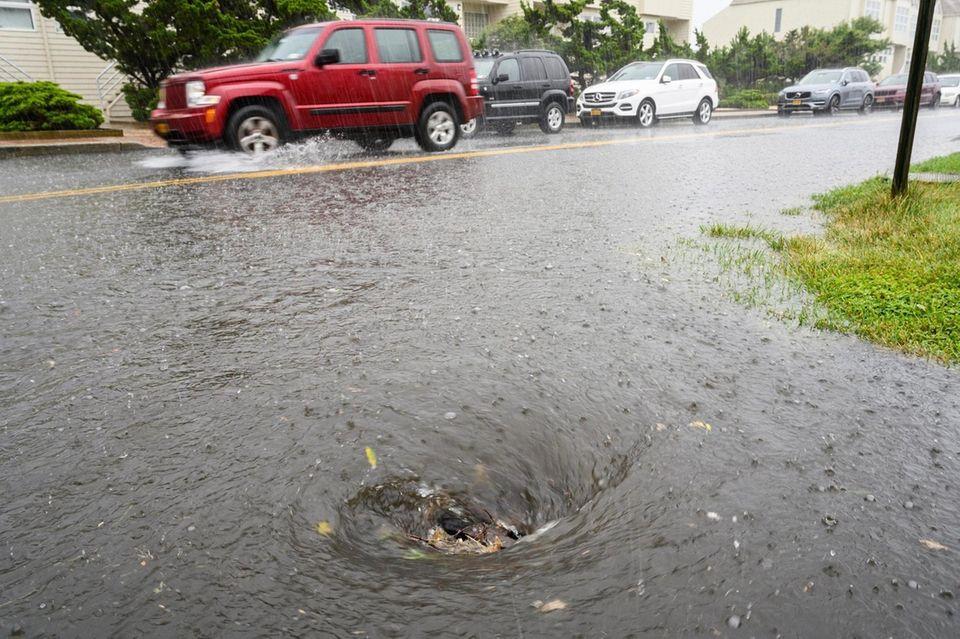 Rain flows down a storm drain on S.