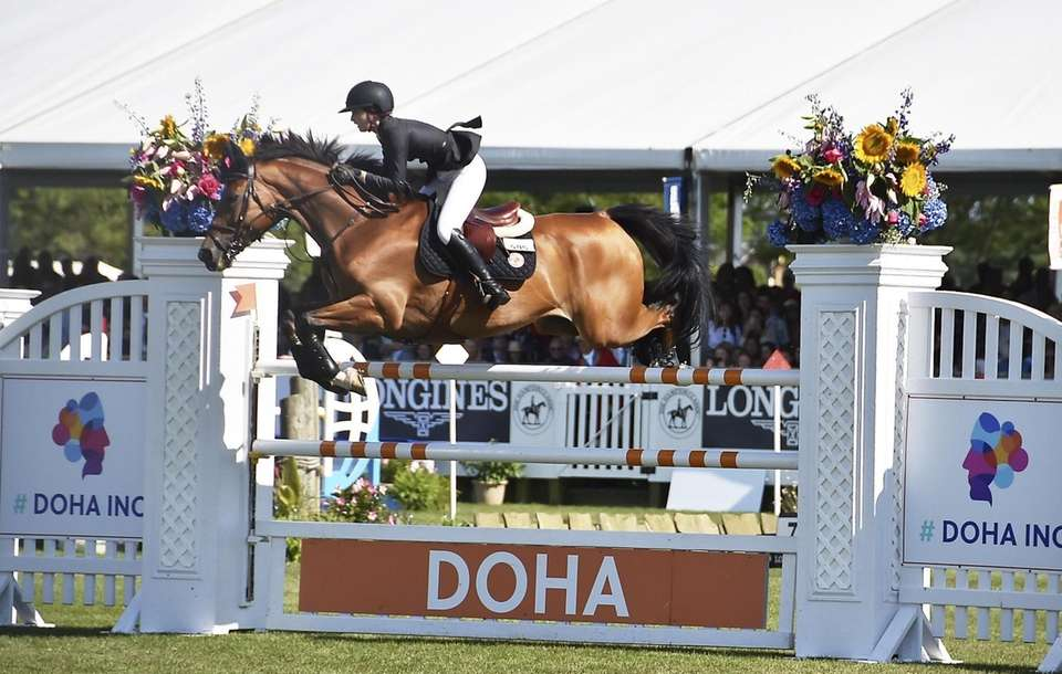 Lucy Deslauries 2nd place winner clears fence at