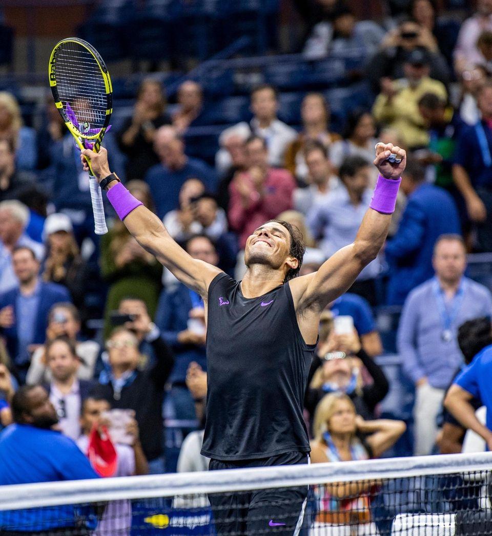Rafael Nadal of Spain raises his arms in