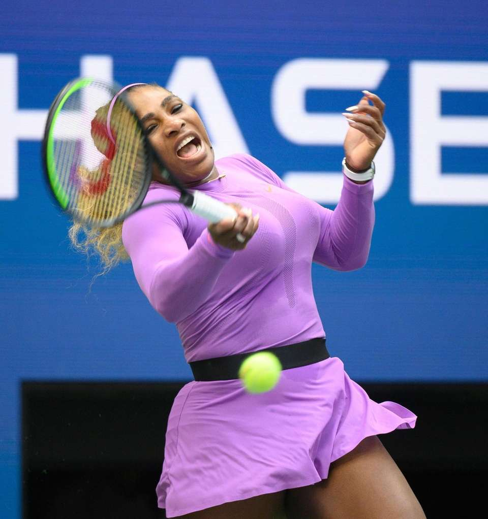 Serena Williams of America hitting a forehand while