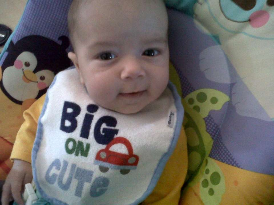 Joshua Michael in his bouncer...Big on Cute!