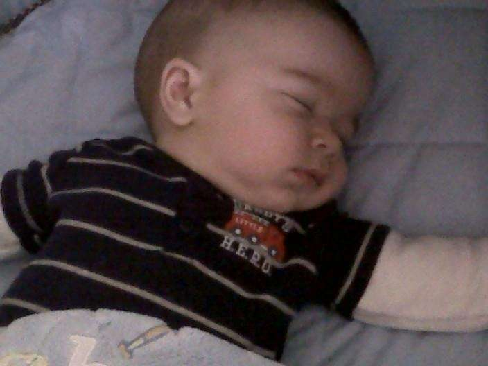 Daddy's Little Hero taking a nap in his