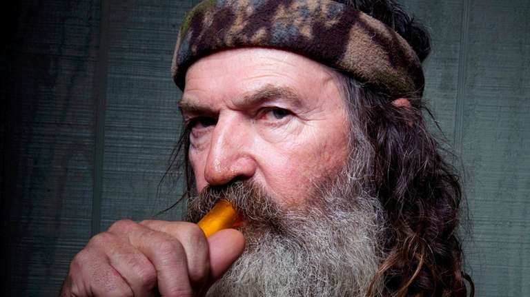Phil Robertson poses with a mouth-blown duck call