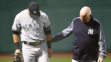 The Yankees' Mike Tauchman leaves the field of