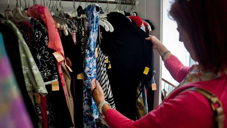 Mary Wezwick, of Glen Head looks at clothing