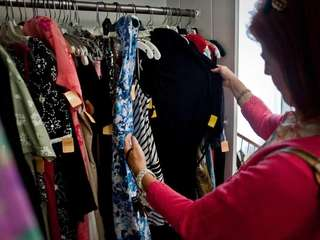 Mary Wezwick, of Glen Head looks at clothing