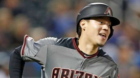 Arizona Diamondbacks' Wilmer Flores runs the bases after