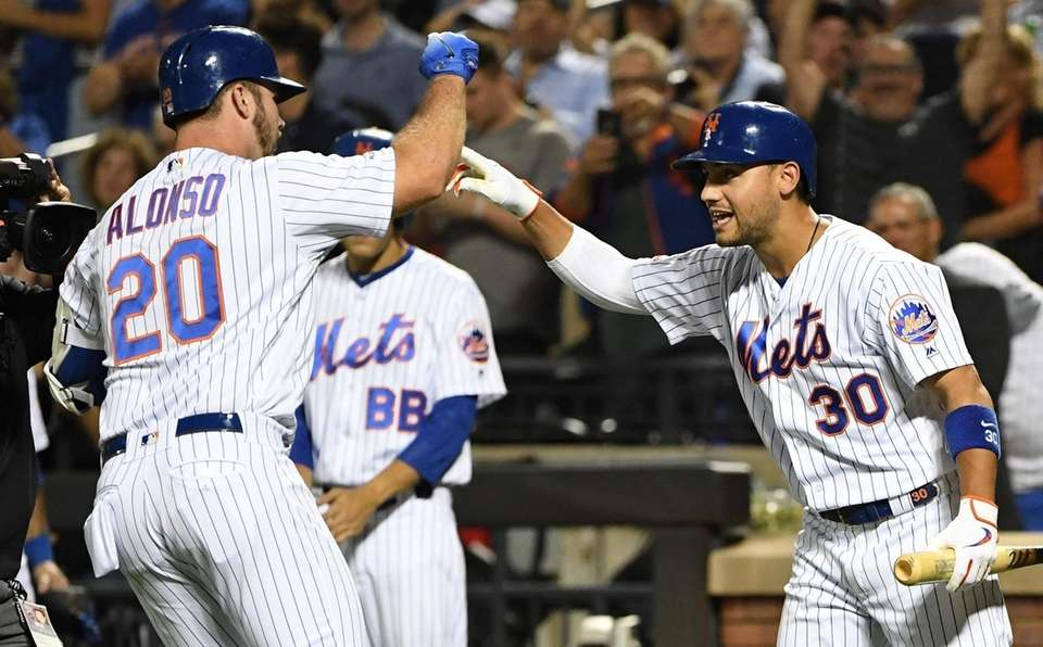 The Mets' Michael Conforto greets Pete Alonso after