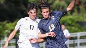 Massapequa's Michael Savella (13) battles for possession with