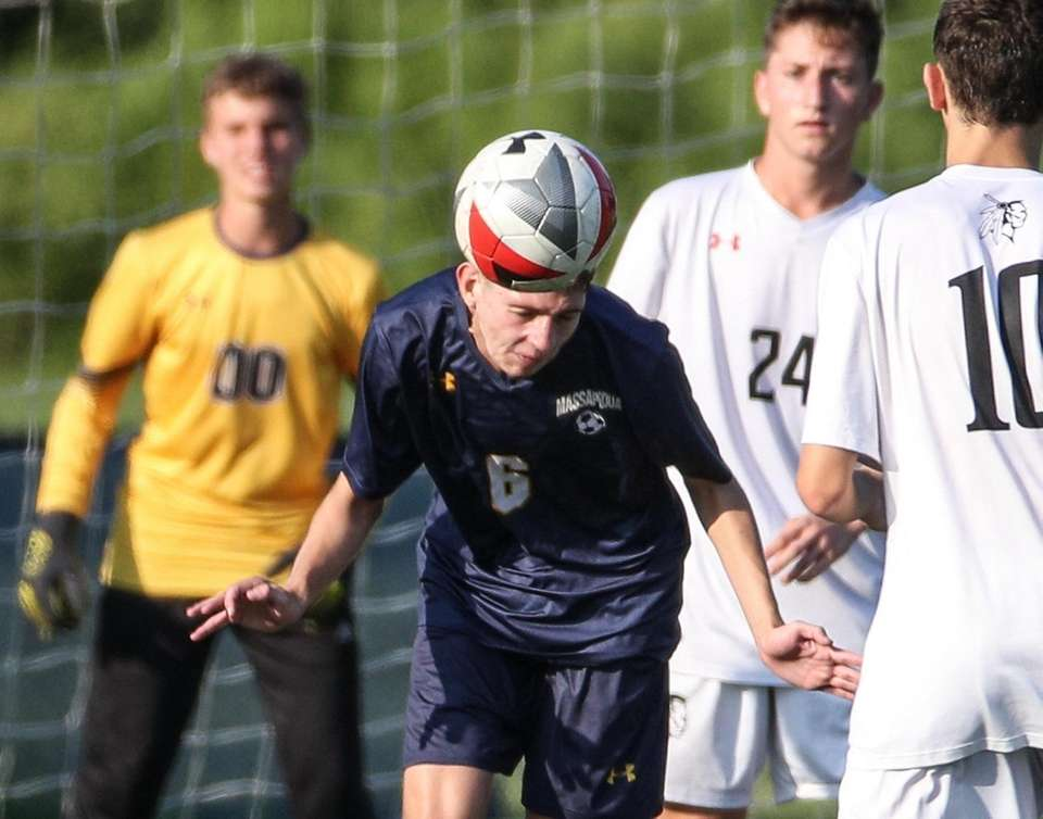 Thomas O'Neil of Massapequa heads the ball in