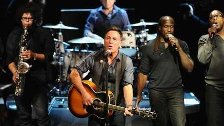 Jake Clemons (L) and Bruce Springsteen at the