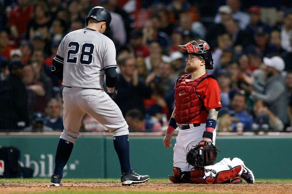 The Boston Red Sox's Christian Vazquez, right, watches