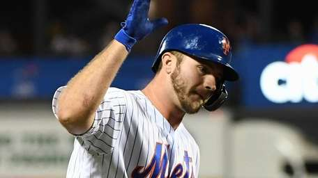 The Mets' Pete Alonso reacts as he runs