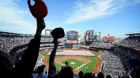 New York Mets fans wave their caps as