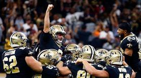 Saints kicker Wil Lutz celebrates his game winning
