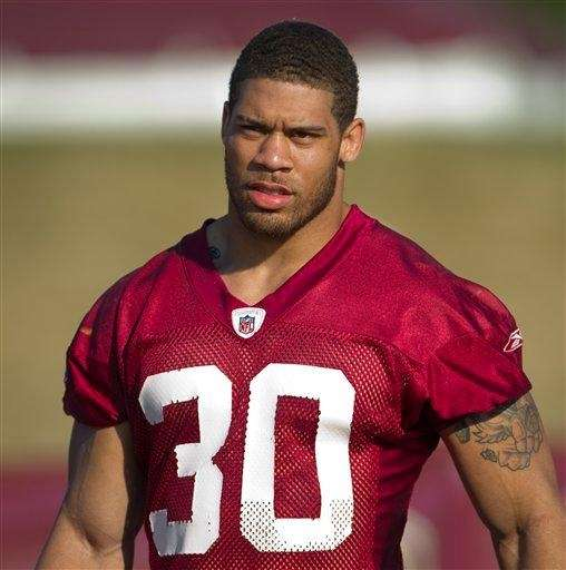 LaRon Landry walks to the Redskins practice field
