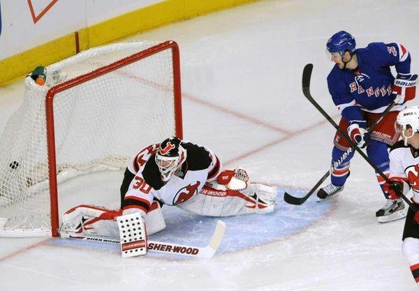 New York Rangers' Derek Stepan, right, watches a