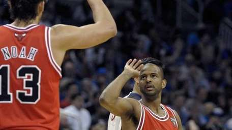 Chicago Bulls guard John Lucas III, right, is