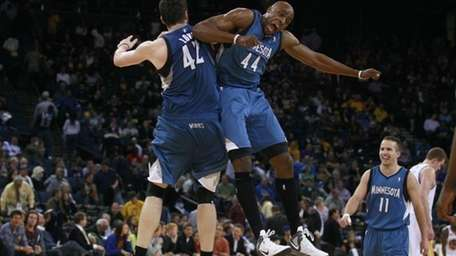 Minnesota Timberwolves' Kevin Love (42) and Anthony Tolliver