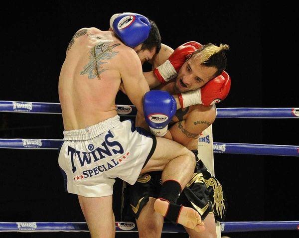 Rich Brattole, left, fights Evaristo Hernandez, right, in