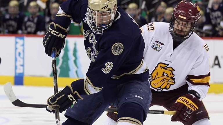 Notre Dame's Anders Lee tries to keep the