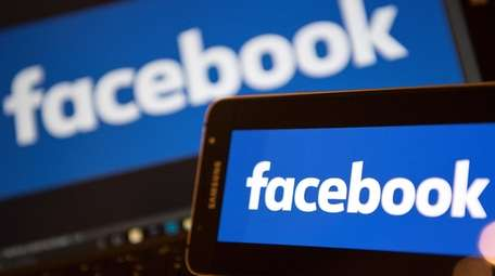 Facebook logos pictured on the screens of a