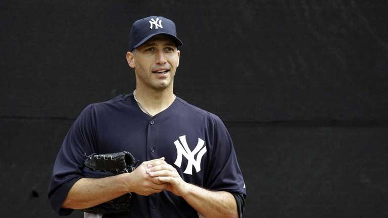 Andy Pettitte prepares for his bullpen session after