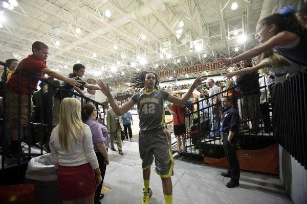 Baylor's Brittney Griner greets fans as she runs