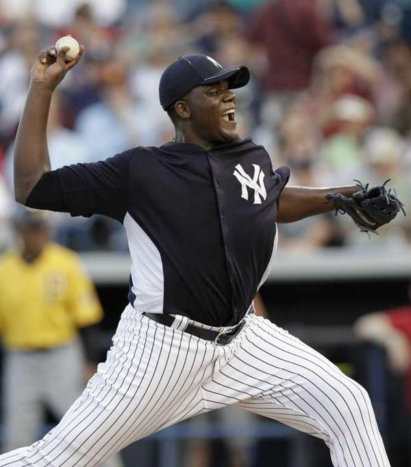 Yankees starting pitcher Michael Pineda delivers during the