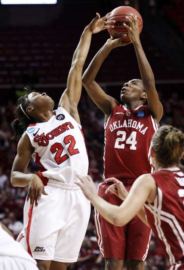 St. John's guard Eugeneia McPherson (22) defends as