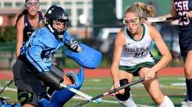 Carle Place forward Olivia Docyk tries to put