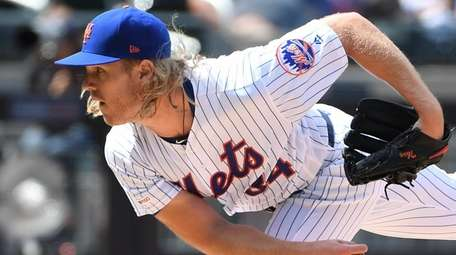 New York Mets starting pitcher Noah Syndergaard delivers