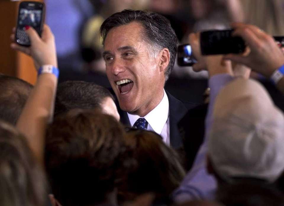 Republican presidential candidate Mitt Romney reacts while greeting