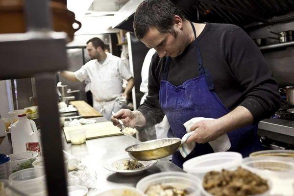 Executive chef Eric Lomando of Stony Brook plates