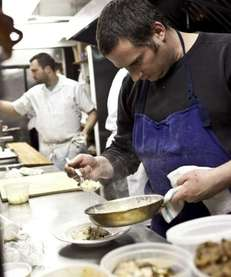 Executive chef Eric Lomando of Stony Brook plates
