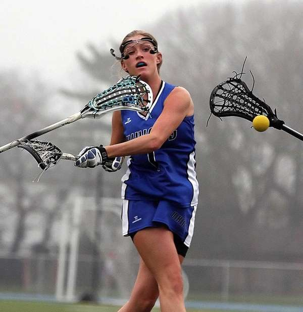 Port Washington's Kaitlyn Brown launches one of her
