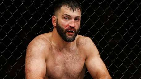 Andrei Arlovski reacts after losing to Augusto Sakai
