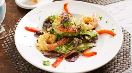 The avocado with grilled shrimp is served with
