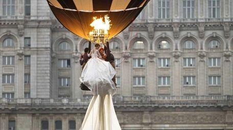 A model rides in a hot air balloon
