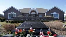 Islandia Village hall and the memorial to lost
